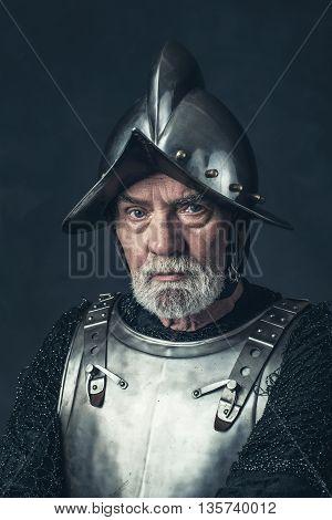 Senior Knight With Gray Beard In Armor.