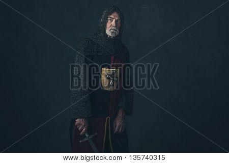 Knight With Beard In Hauberk Holding Sword.
