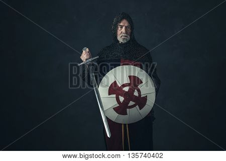 Knight With Gray Beard Holding Sword And Shield.