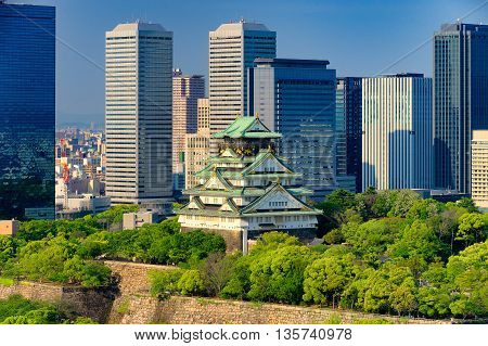 Himeji As Known As Osaka Castle Against The Skyscrapper.