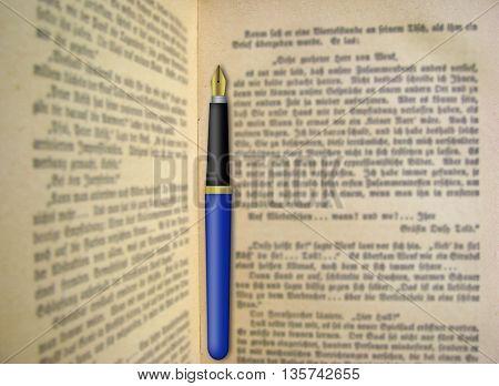 Fountain pen on open book