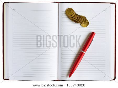 notebook pen and money. notebook isolated closeup