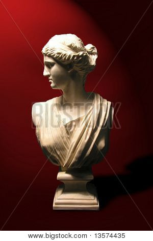A photo of a statue of a roman goddess