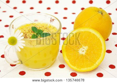 Fresh lemonade with mint leaves and sliced lemon,isolated on homey red dotted background
