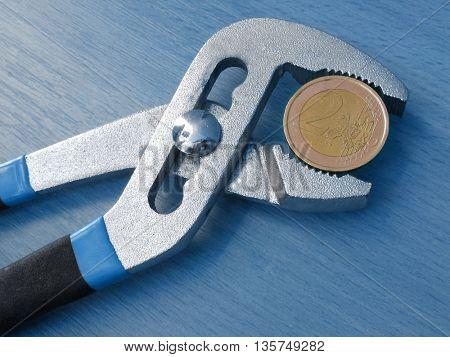 one euro coin under pressure