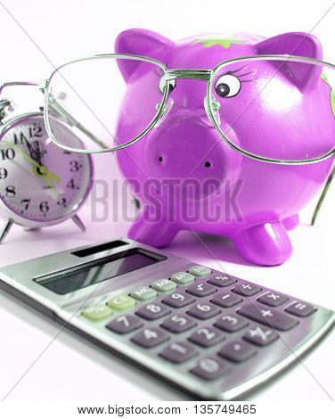 ,calculator,clock  ,piggy bank and glasses-business concept