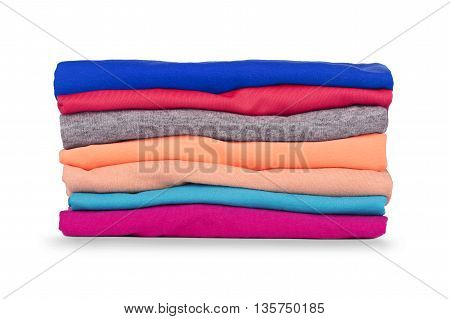 Pile of colorful clothes isolated on white background