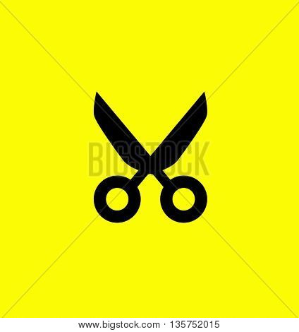 black scissors isolated on yellow background