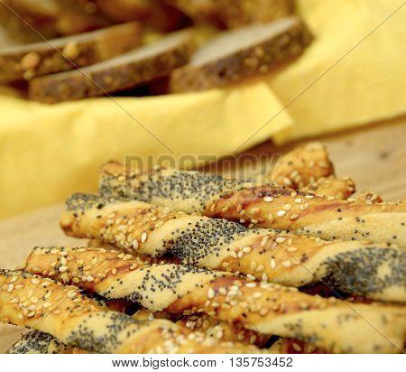 salty sticks with sesame and poppy seeds, Bread sticks or Pretzel sticks