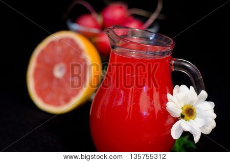 red juices in glasses and fruits and vegetables