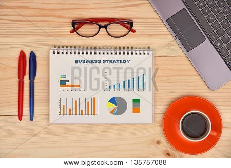 Notepad With Drawing Business Strategy Concept