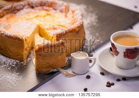 Cheese poppy cake with coffee and cream