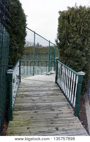 A boardwalk leads to tennis courts in Harbor Point, Michigan.