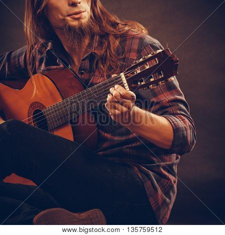 Boy With Wooden Guitar.