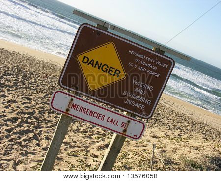 A photo of a danger sign at the beach