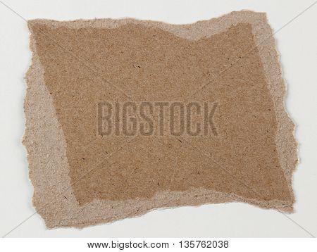 Piece of torn brown paper