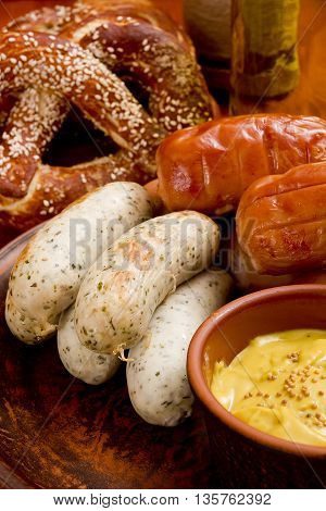 Traditional German sausages and mustard on pottery