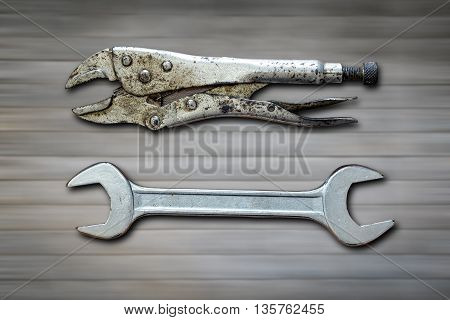 Wrenchs On Wood Background.