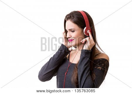 Girl listening to the music isolated on a white background