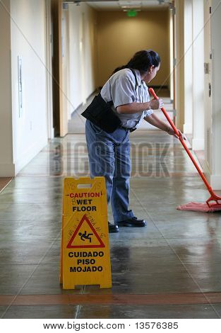 A photo of a janitor mopping