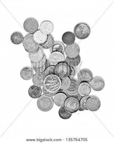 Various currency of used coins in grey
