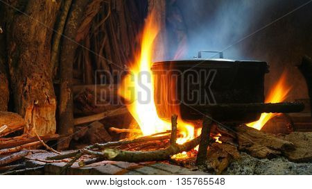 Hot pot on fire of burning wood