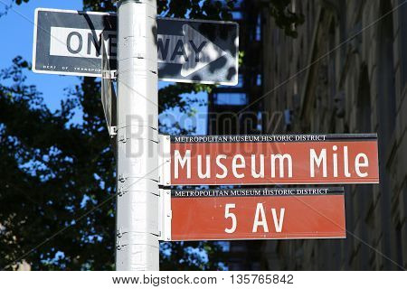 NEW YORK - JUNE 14, 2016: Street Signs along Museum Mile in Manhattan. Museum Mile is the name for a section of Fifth Avenue running from 82nd to 105th streets on the Upper East Side