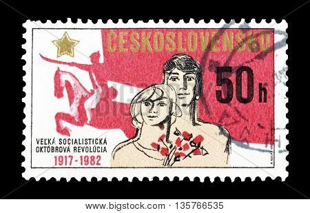 CZECHOSLOVAKIA - CIRCA 1982 : Cancelled postage stamp printed Czechoslovakia, that shows 65th Anniversary of October revolution.