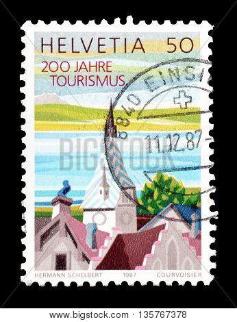 SWITZERLAND - CIRCA 1987 : Cancelled postage stamp printed by Switzerland, that shows Zyt tower in Zug.