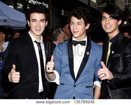 Kevin Jonas, Joe Jonas and Nick Jonas at the World premiere of 'Jonas Brothers: The 3D Concert Experience' held at the El Capitan Theater in Hollywood, USA on February 24, 2009.