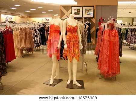 A photo of mannequins wearing various fashion dresses