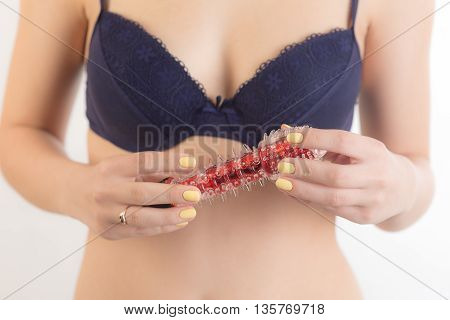 woman in bra holding a red vibrator