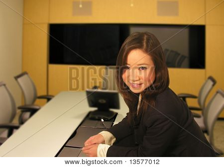 A photo of a business woman in a meeting