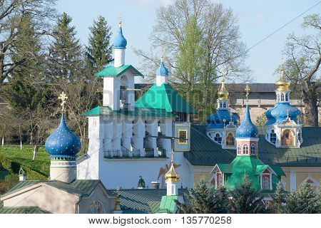 View on the bell tower of the Holy Dormition Pskov-caves monastery, may morning. Pechory, Pskov region, Russia