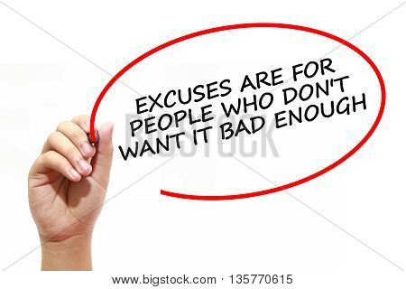 Man writing EXCUSES ARE FOR PEOPLE WHO DON'T WANT IT BAD ENOUGH with marker on transparent wipe board.