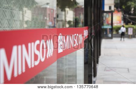 Guangzhou, China - Jun 14, 2016: Close up of the logo of Miniso in front of a store at a shopping street in Guangzhou. Miniso is a Japanese fast fashion brand, headquartered in Tokyo.