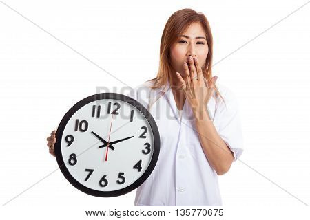 Young Asian Female Doctor Yawn With A Clock