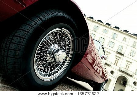 Close up of a tire of a red vintage car
