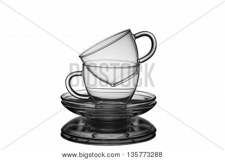 Glass empty cups with saucers for tea isolated on a white background