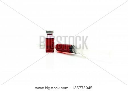 Syringe With Blood Isolated On White Background.