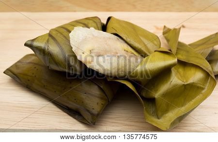 Khao Tom Mad Or Khao Tom Pad,bananas In Sticky Rice,thai Cuisine On Wood Background