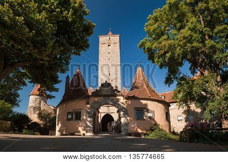 Green trees and buildings in a town of Rothenburg