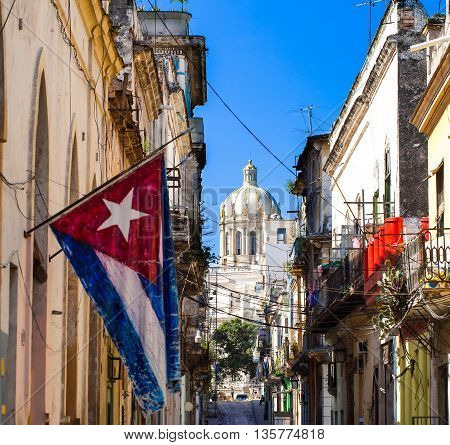 The view of the Capitol with cuban national flag in the front view
