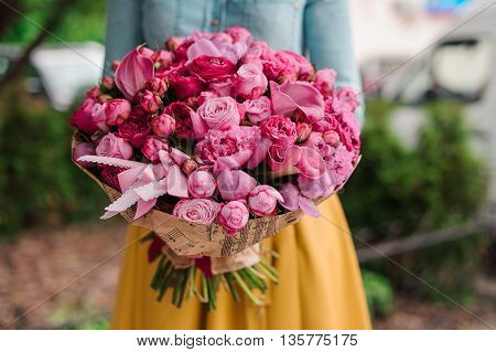 girl holding a bouquet of pink flowers no face
