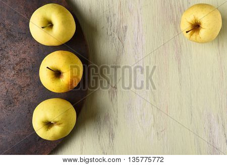 Golden Delicious apples still life with copy space.