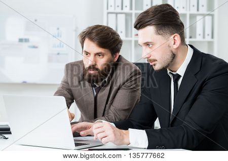 Attractive Men Discussing Business Project