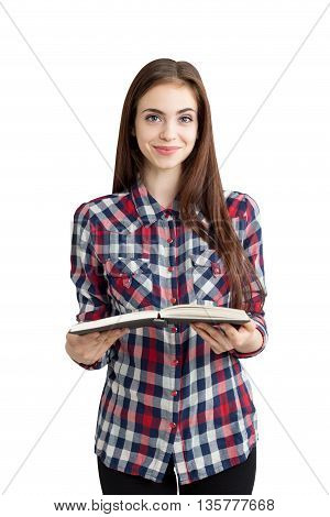Pretty caucasian girl in casual outfit isolated on white background holding open book. Education concept