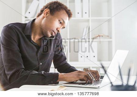 Man On Phone Keyboarding