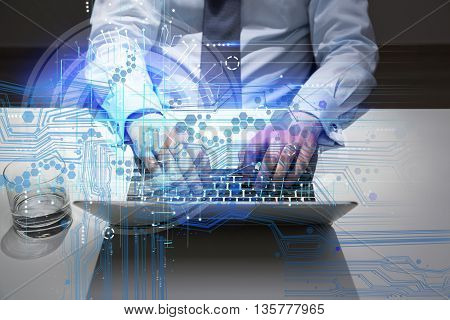 Closeup of businessman using laptop with abstract digital pattern at office desk with glass of water