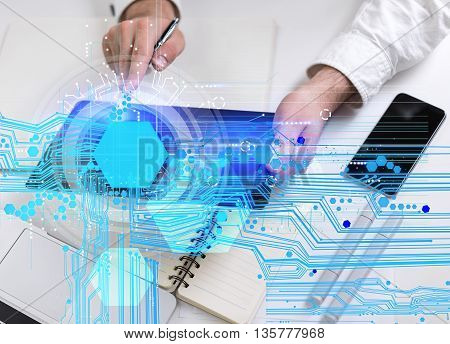 Top view of male hands using tablet with abstract digital pattern on office desktop with smartphone and stationery items